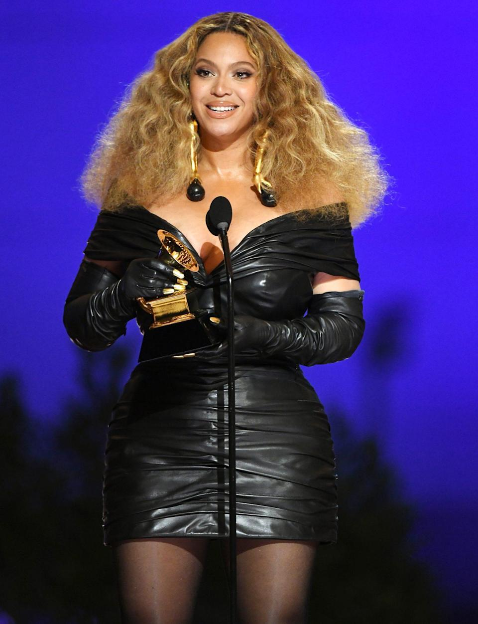 "<p>In 2021, Beyoncé <a href=""https://people.com/music/grammys-2021-beyonce-makes-history-most-decorated-female-artist/"" rel=""nofollow noopener"" target=""_blank"" data-ylk=""slk:broke the record for most Grammys won by a woman"" class=""link rapid-noclick-resp"">broke the record for most Grammys won by a woman</a> <em>and </em>most Grammys won by any singer, male or female. </p> <p>She and her 9-year-old daughter, Blue Ivy, <a href=""https://people.com/music/grammys-2021-beyonce-wins-best-r-and-b-performance/"" rel=""nofollow noopener"" target=""_blank"" data-ylk=""slk:earned a Grammy for best music video for &quot;Brown Skin Girl,&quot;"" class=""link rapid-noclick-resp"">earned a Grammy for best music video for ""Brown Skin Girl,""</a> and Bey won a Grammy for best R&B performance for ""Black Parade"" plus two more for her <a href=""https://people.com/music/grammys-2021-beyonce-megan-thee-stallion-win-best-rap-song/"" rel=""nofollow noopener"" target=""_blank"" data-ylk=""slk:collaboration with Megan Thee Stallion"" class=""link rapid-noclick-resp"">collaboration with Megan Thee Stallion</a>. The duo took home prizes for best rap performance and best rap song for ""Savage."" In total, the singer has 79 nominations to her name.</p> <p><strong>Beyoncé's Grammy Tally: </strong>28</p>"