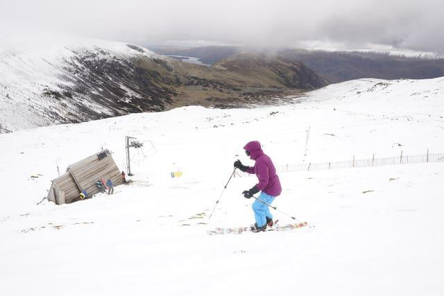 A skier makes their way down the slope at the Lake District Ski Club