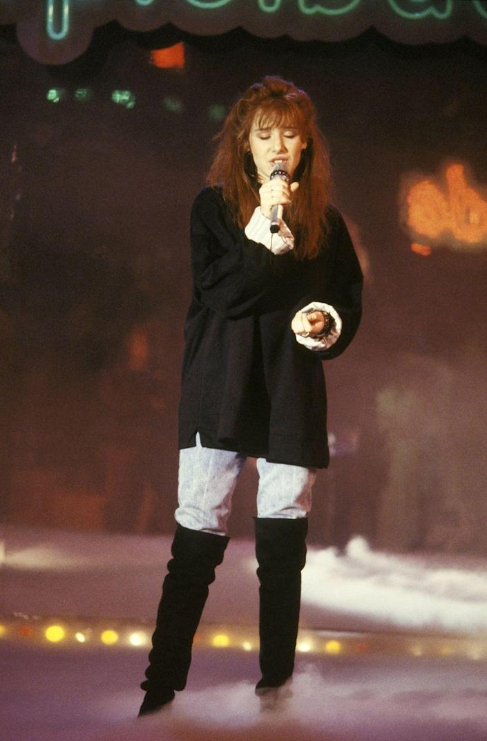 """<p>Thanks to Tiffany and her many, <em>many</em> mall performances in the '80s, we had """"I Think We're Alone Now"""" stuck in our heads for years. The singer was a huge name in music during the decade, thanks to the hit song. </p>"""