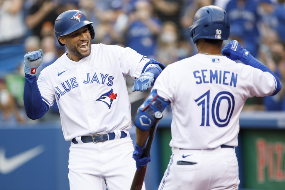 TORONTO, ON - AUGUST 04: George Springer #4 of the Toronto Blue Jays and Marcus Semien #10 celebrate Springer's home run in the first inning of their MLB game against the Cleveland Indians at Rogers Centre on August 4, 2021 in Toronto, Ontario. (Photo by Cole Burston/Getty Images)