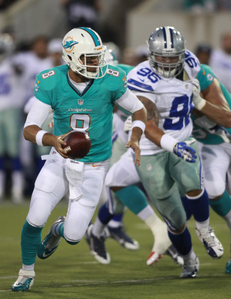 Miami Dolphins quarterback Matt Moore (8) runs the ball against the Dallas Cowboys in the first quarter at the Pro Football Hall of Fame exhibition football game, Sunday, Aug. 4, 2013, in Canton, Ohio. (AP Photo/Scott R. Galvin)