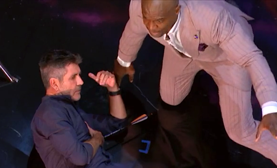 Terry Crews react after Simon Cowell is shot with an arrow on 'America's Got Talent.' (Photo: NBC)