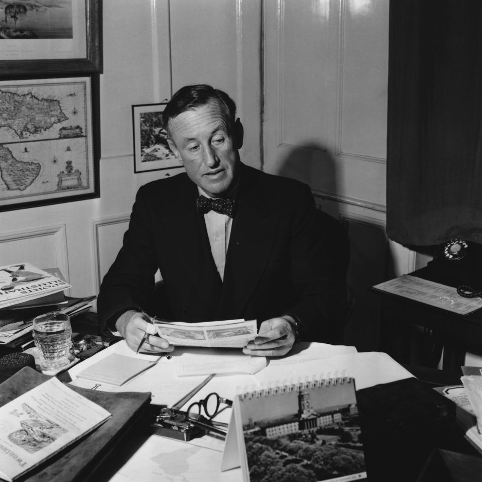 Ian Fleming (1908-1974) the English novelist in his study (1958). He worked as naval intelligence officer during the Second World War, an experience that provided him with the material for 12 novels and 7 short stories featuring his famous hero James Bond. (Photo by © Hulton-Deutsch Collection/CORBIS/Corbis via Getty Images)