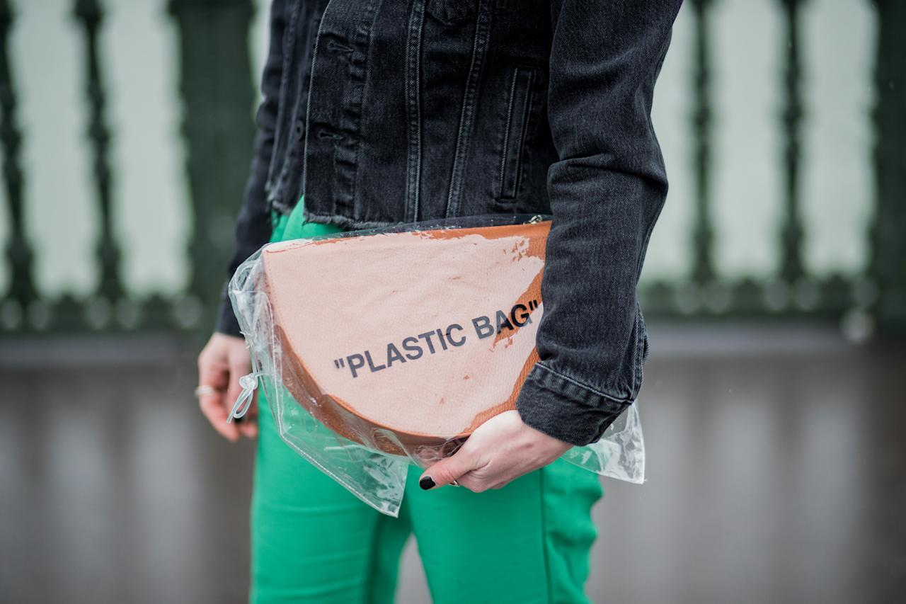 """<p>Model carries an Off-White clear """"Plastic Bag."""" (Photo: Getty Images) </p>"""