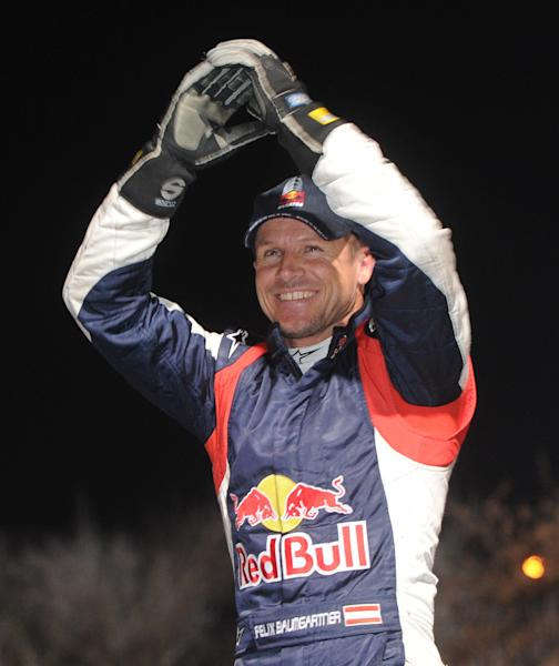 """FILE - In a Saturday, Dec. 1, 2012 file photo, Austrian supersonic skydiver Felix Baumgartner greets the audience during the 50th Barborka Rally in Warsaw, Poland. According to the official numbers released Monday, Feb. 4, 2013, the Austrian parachutist known as """"Fearless Felix"""" reached 843.6 mph. That's equivalent to Mach 1.25, or 1.25 times the speed of sound. His top speed initially was estimated last October at 834 mph, or Mach 1.24. (AP Photo/Alik Keplicz, File)"""