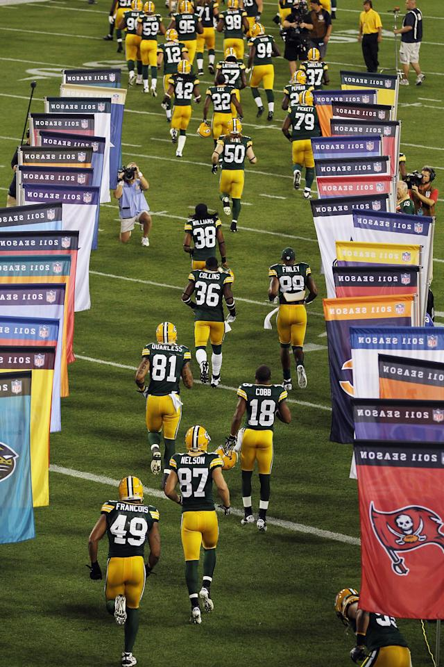 GREEN BAY, WI - SEPTEMBER 08: The Green Bay Packers run onto the field before taking on the New Orleans Saints in the season opening game at Lambeau Field on September 8, 2011 in Green Bay, Wisconsin. (Photo by Jonathan Daniel/Getty Images)