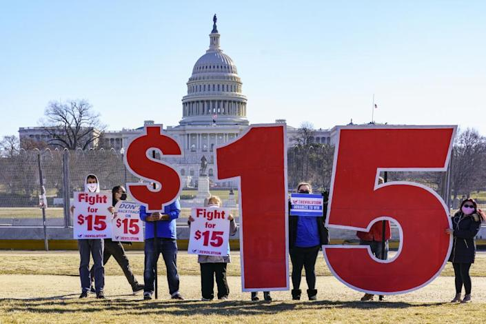 Activists show support for a $15 minimum wage near the Capitol in Washington DC on 25 February.