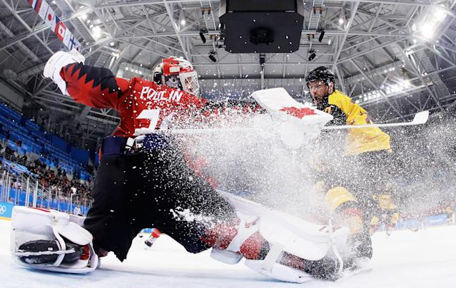 <p>Kevin Poulin #31 of Canada defends against Marcus Kink #17 of Germany during the Men's Play-offs Semifinals on day 14 of the PyeongChang 2018 Winter Olympic Games in Gangneung, South Korea on February 23, 2018.<br> (Photo by Pool/Getty Images) </p>