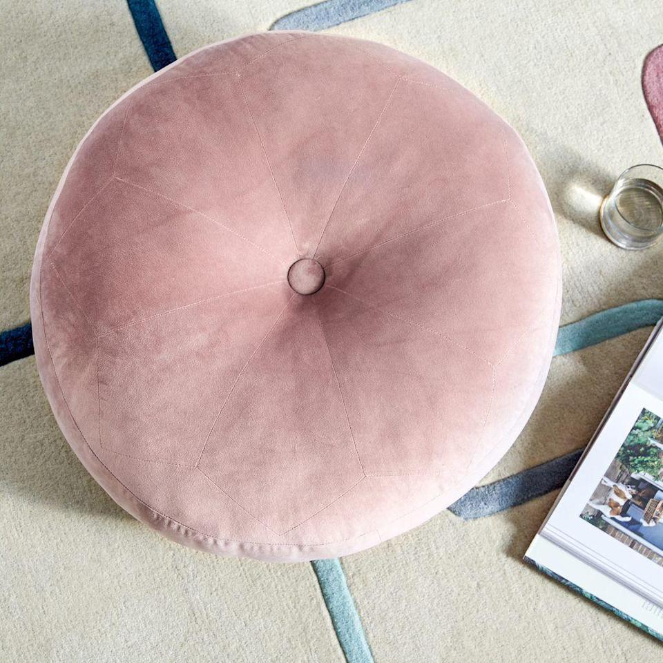 "<h3>Circular Velvet Floor Pillow</h3><p>Channel carefree style this season with a plush oversized floor pillow that doubles as a bohemian seating solution. One reviewer gushes: ""This floor pillow is absolutely adorable! It's the perfect size to throw in the corner and use as an extra seat when guests come over. The velvet is super soft and the blush pink color looks great with the rest of my decor. It's actually a little bigger than it seems in the picture - thick enough to provide lots of cushion for someone sitting on it. Overall, great value - I wish it came in more colors!""</p><br><br><strong>MoDRN</strong> retro Glam Circular Velvet Floor Pillow, Mauve, $34, available at <a href=""https://www.walmart.com/ip/MoDRN-retro-Glam-Circular-Velvet-Floor-Pillow-Mauve/777473239"" rel=""nofollow noopener"" target=""_blank"" data-ylk=""slk:Walmart"" class=""link rapid-noclick-resp"">Walmart</a>"