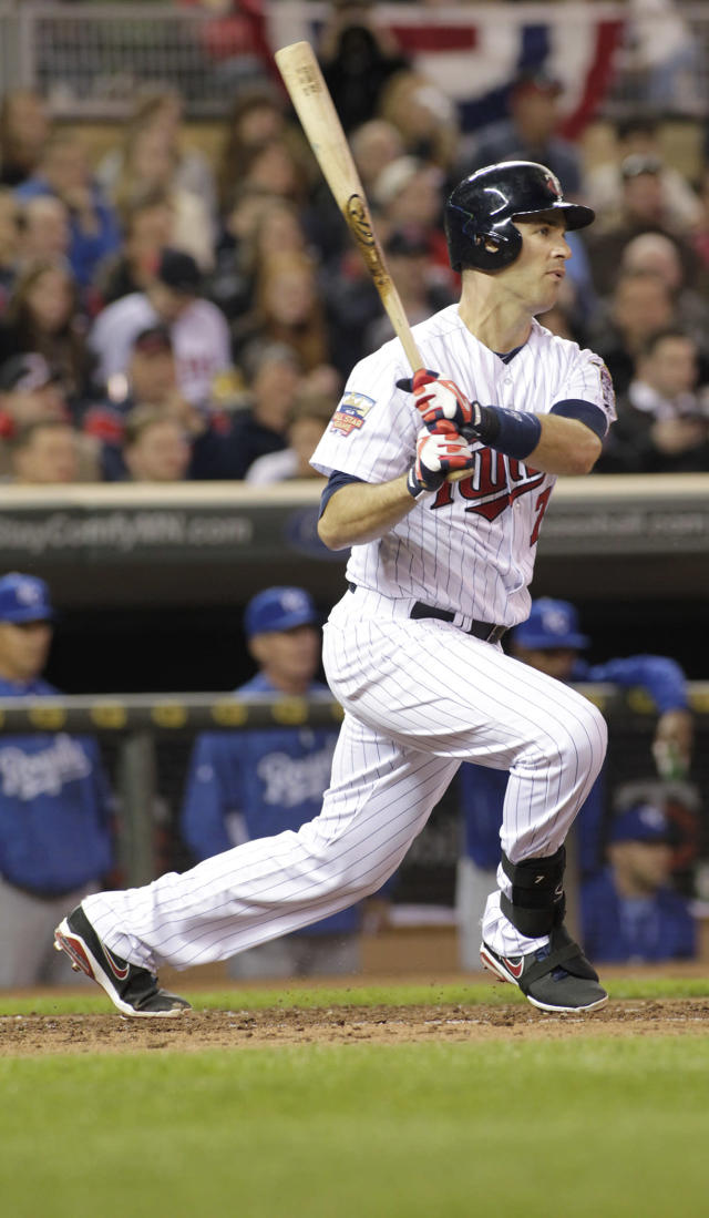 Minnesota Twins first baseman Joe Mauer (7) heads to first on a single during the fourth inning of a baseball game against the Kansas City Royals, Friday, April 11, 2014, in Minneapolis. AP Photo/Paul Battaglia)