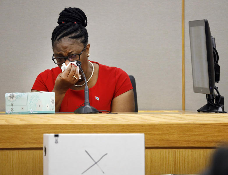Botham Jean's mother, Allison Jean, cries while speaking about her son during sentencing testimony for former Dallas Police Officer Amber Guyger in 204th District Court at the Frank Crowley Courts Building in Dallas, Tuesday, Oct. 1, 2019. Guyger, who shot her black unarmed neighbor Botham Jean to death after, she said, mistaking his apartment for her own, was convicted of murder Tuesday. (Tom Fox/The Dallas Morning News via AP, Pool)