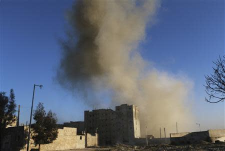 Smoke rises after what activists said was shelling by forces loyal to Syria's President Bashar al-Assad, in the al-Myassar neighbourhood of Aleppo February 7, 2014. REUTERS/Hosam Katan