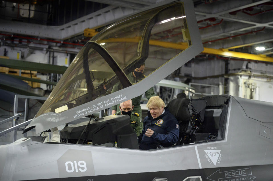 Britain's Prime Minister Boris Johnson sits in the cockpit of an Lockheed Martin F-35 Lightning II during a visit aboard HMS Queen Elizabeth in Portsmouth, England, Friday, May 21, 2021 ahead of its first operational deployment to the Far East. (Leon Neal/Pool Photo via AP)