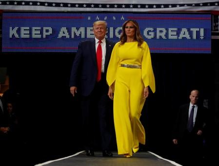 U.S. President Donald Trump and first lady Melania Trump arrive on stage to formally kick off his re-election bid with a campaign rally in Orlando