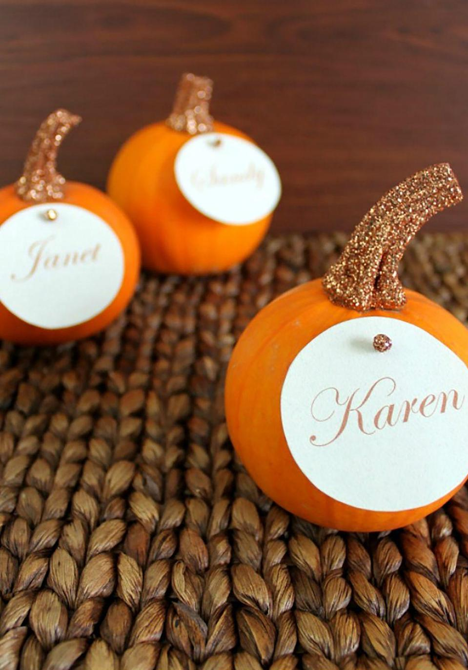 "<p>With just a little bit of glue and glitter, you can spruce up mini pumpkins to make adorable table place cards. </p><p><strong>Get the tutorial at <a href=""https://www.ohmy-creative.com/holiday-crafts/thanksgiving/glitter-top-pumpkin-place-cards/"" rel=""nofollow noopener"" target=""_blank"" data-ylk=""slk:Oh My! Creative"" class=""link rapid-noclick-resp"">Oh My! Creative</a>. </strong></p><p><strong><a class=""link rapid-noclick-resp"" href=""https://www.amazon.com/American-Crafts-Glitter-Extra-Chocolate/dp/B00785X37C/?tag=syn-yahoo-20&ascsubtag=%5Bartid%7C10050.g.1538%5Bsrc%7Cyahoo-us"" rel=""nofollow noopener"" target=""_blank"" data-ylk=""slk:SHOP CRAFT GLITTER"">SHOP CRAFT GLITTER</a></strong></p>"