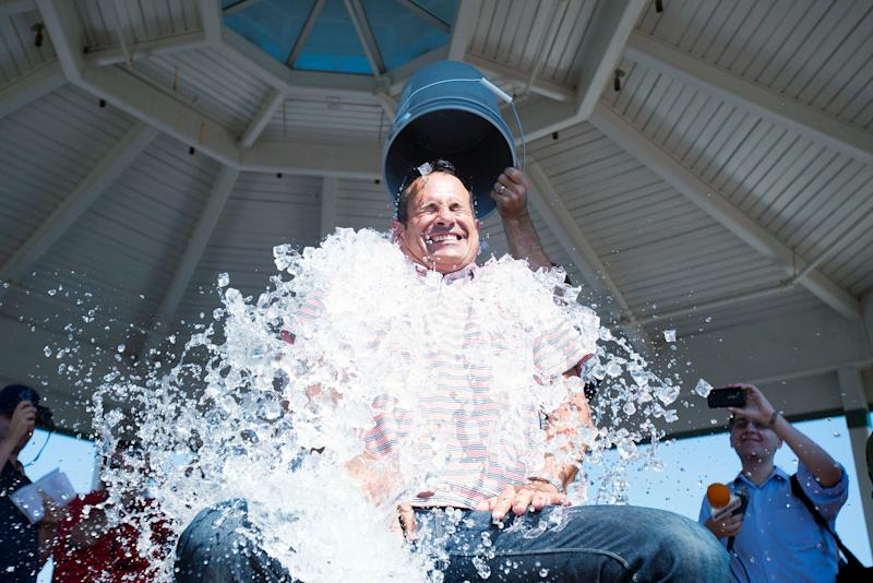 Dogfish Head founder Sam Calagione participates in the ALS ice bucket challenge with NASCAR's Jeff Gordon doing the honors in front of hundreds of gatherers by the Rehoboth Beach bandstand after a question-and-answer session.