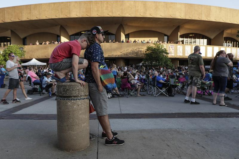 Franklin and his son Evan, from Dodge City view a concert near the Century II Performing Arts & Convention Center.