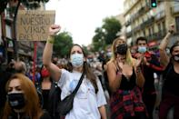 People attend a demonstration at the Vallecas neighborhood in Madrid to protest new restrictive measures announced by regional authorities