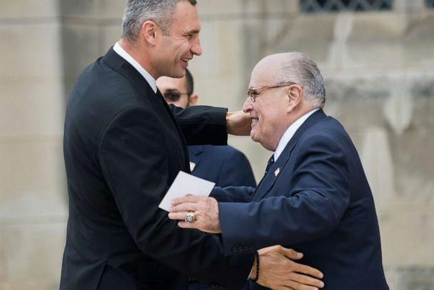 PHOTO: Rudy Giuliani, right, greets Mayor of Kyiv, Vitali Klitschko, before for the funeral of the late Sen. John McCain, at the Washington National Cathedral on Sept. 1, 2018 in Washington, D.C. (CQ-Roll Call, Inc via Getty Images, FILE)