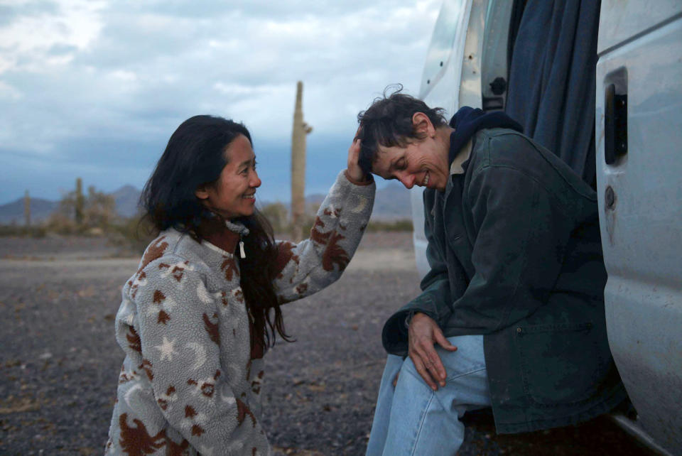 """Director Chloe Zhao, left, appears with actress Frances McDormand on the set of """"Nomadland."""" (Searchlight Pictures via AP)"""