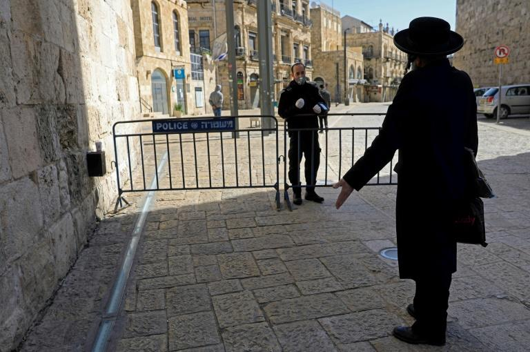 A unity government would aim to combat the coronavirus pandemic, which has so far seen over 3,800 Israelis infected and claimed 12 lives in the country (AFP Photo/Emmanuel DUNAND)
