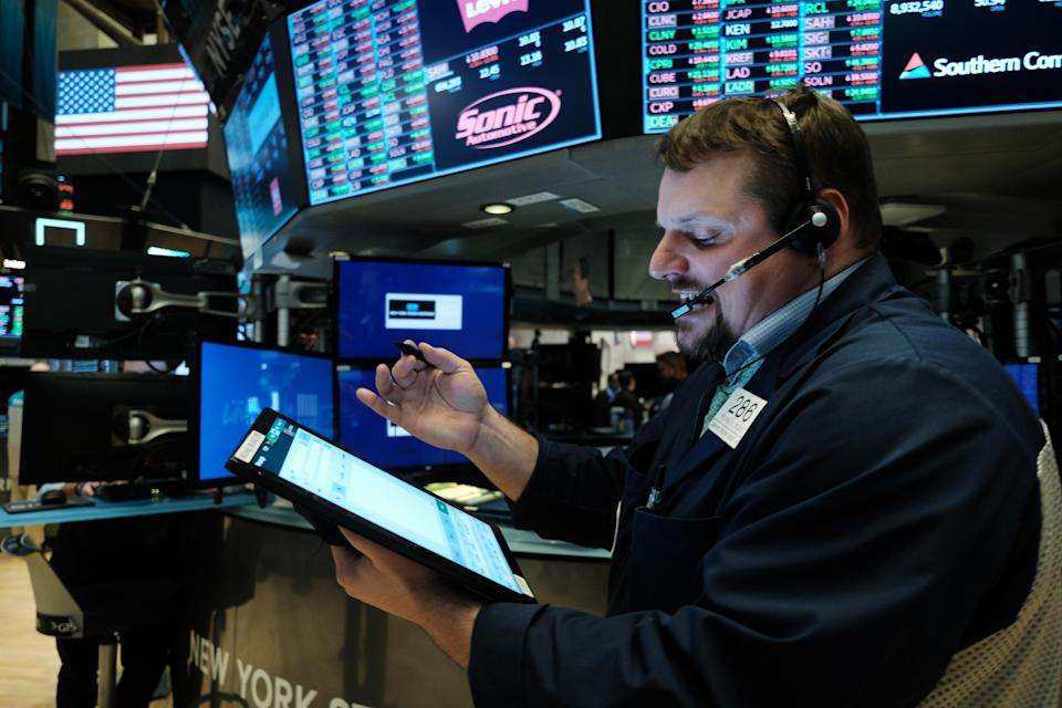 NEW YORK, NEW YORK - MARCH 20: Traders work on the floor of the New York Stock Exchange (NYSE) on March 20, 2020 in New York City. Trading on the floor will temporarily become fully electronic starting on Monday to protect employees from spreading the coronavirus. The Dow fell over 500 points on Friday as investors continue to show concerns over COVID-19. (Photo by Spencer Platt/Getty Images)