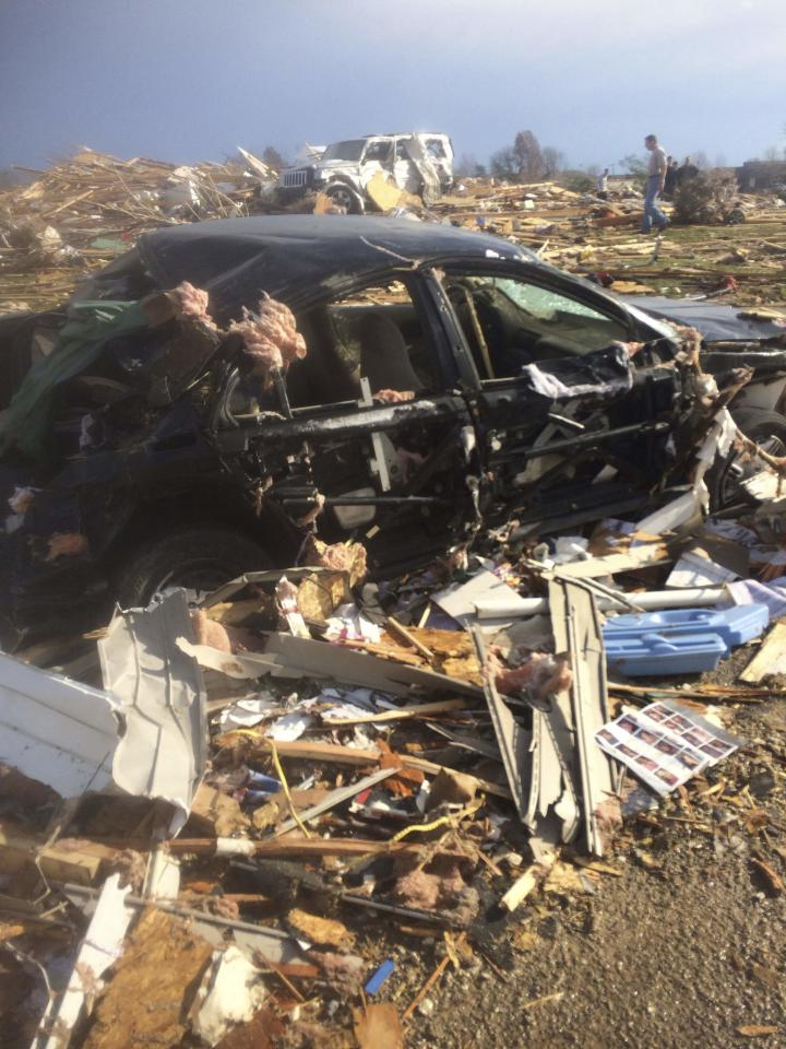 Extensive damage to homes and vehicles is pictured in the aftermath of tornado that touched down in Washington, Illinois