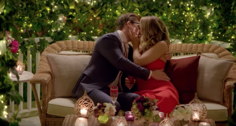 Abbie Chatfield in a red dress kisses Matt Agnew on The Bachelor 2019