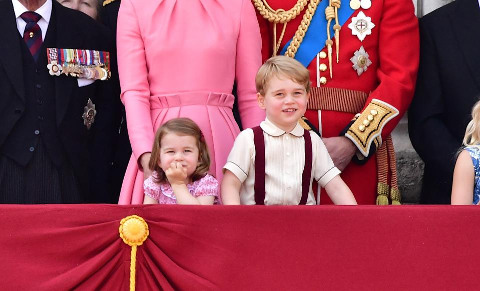 LONDON, ENGLAND - JUNE 17:  Princess Charlotte of Cambridge and Prince George of Cambridge stand on the balcony of Buckingham Palace during the Trooping the Colour parade on June 17, 2017 in London, England.  (Photo by James Devaney/WireImage)