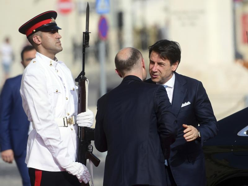 Italian Premier Giuseppe Conte, right, is welcomed by Malta Prime Minister Joseph Muscat, on the occasion of the Mediterranean Summit of Southern EU countries in Valetta, Malta, Friday, June 14, 2019. (AP Photo/Jonathan Borg)
