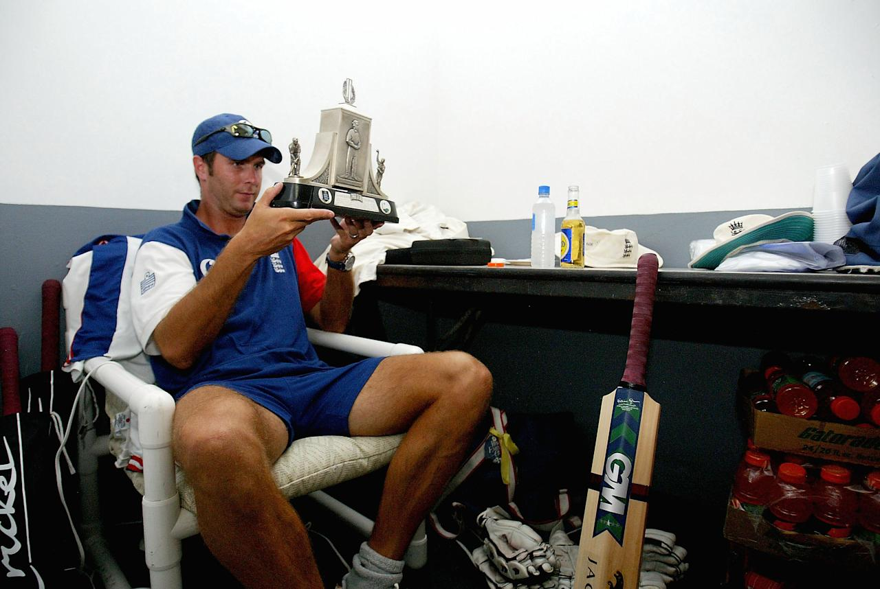 ST JOHNS, ANTIGUA - APRIL 14:  Michael Vaughan the England captain holds the Wisden Trophy in the dressing room after winning the series 3-0 during day five of the 4th Test match between the West Indies and England at the Recreation Ground on April 14, 2004 in St Johns, Antigua. (Photo by Tom Shaw/Getty Images)