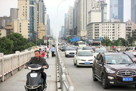 Vehicles and pedestrians travel on a road in Changsha