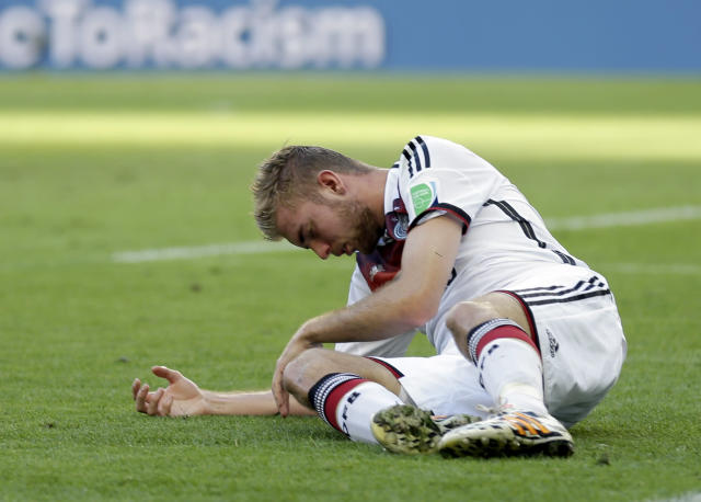 Germany's Christoph Kramer lies on the pitch after getting hit in the face by Argentina's Ezequiel Garay's shoulder during the World Cup final soccer match between Germany and Argentina at the Maracana Stadium in Rio de Janeiro, Brazil, Sunday, July 13, 2014. (AP Photo/Natacha Pisarenko)