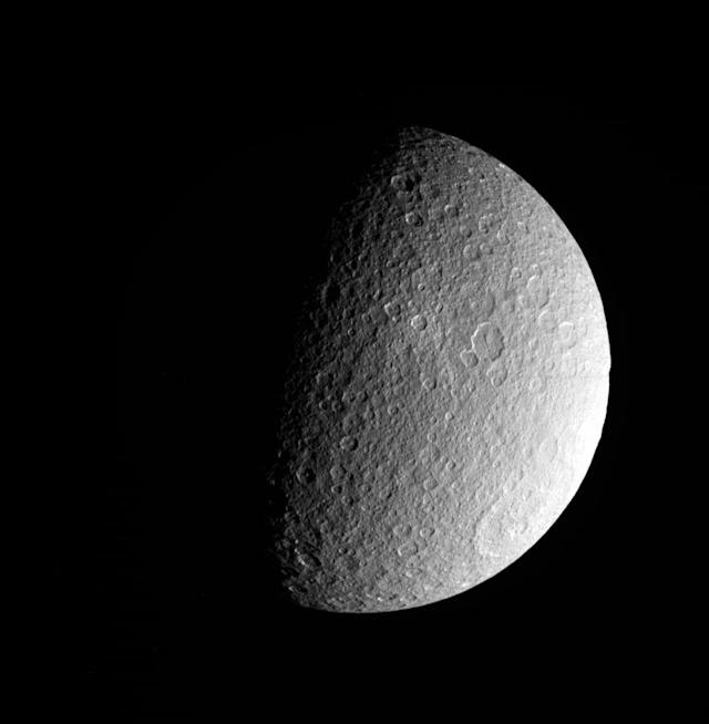 This photo made March 10, 2012, by NASA's Cassini spacecraft shows a raw, unprocessed image of Saturn's moon Rhea. The camera was pointing toward Rhea from a distance of approximately 42,096 kilometers (26,157 miles). (AP Photo/NASA/JPL-Caltech/SSI)