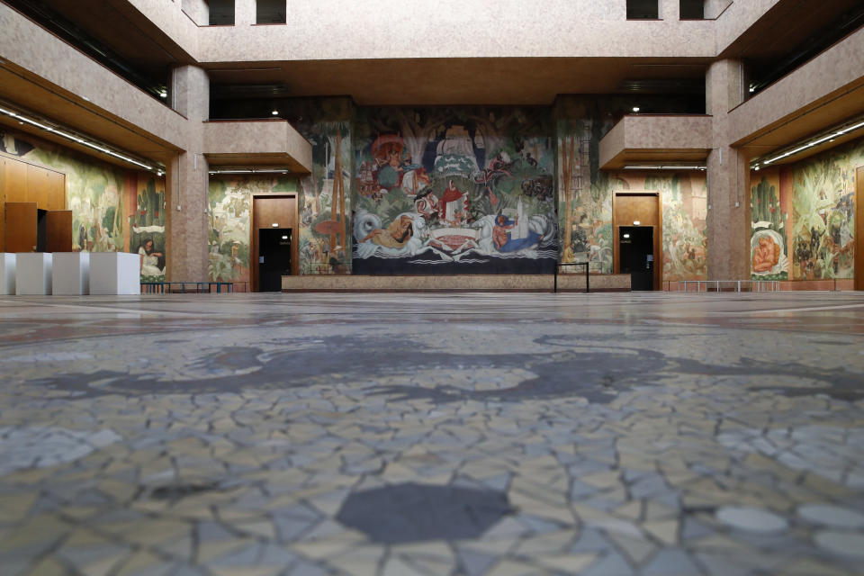 """An interior view of France's National Museum of the History of Immigration showing a 1931 mural by French artist Pierre Ducos de la Haille, in Paris, Thursday, March 11, 2021. Pap Ndiaye, a Black French scholar and expert on U.S. minority rights movements who is taking over France's state-run immigration museum, considers it """"vital"""" for his country to confront its colonial past so that it can conquer the racial injustice of the present. (AP Photo/Francois Mori)"""