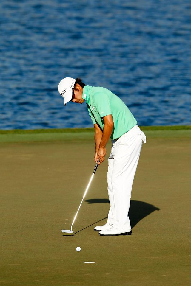 PONTE VEDRA BEACH, FL - MAY 11: Kevin Na of the United States putts on the 17th green during the second round of THE PLAYERS Championship held at THE PLAYERS Stadium course at TPC Sawgrass on May 11, 2012 in Ponte Vedra Beach, Florida. (Photo by Mike Ehrmann/Getty Images)