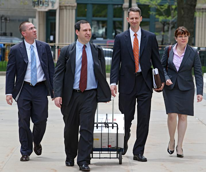 Hobby Lobby Attorney Kyle Duncan, second from right, and members of his team arrive at the federal courthouse in Denver on Thursday, May 23, 2013, for a full 10th Circuit hearing challenging the federal health care law. Hobby Lobby stores is challenging a federal mandate requiring it to offer employees health coverage that includes access to the morning-after birth control pill. The Oklahoma based arts and crafts chain says the mandate violates the religious beliefs of its owners. (AP Photo/Ed Andrieski)