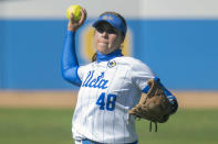 FILE - UCLA center fielder Bubba Nickles (48) throws during an NCAA softball game against Fresno State in Los Angeles, in this Friday, Feb. 12, 2021, file photo. Division I softball is providing a training ground this season for players preparing for the 2021 Olympics. Nickles is among 18 members of Team USA fighting for 15 spots on the squad that will go to Tokyo. (AP Photo/Kyusung Gong, File)