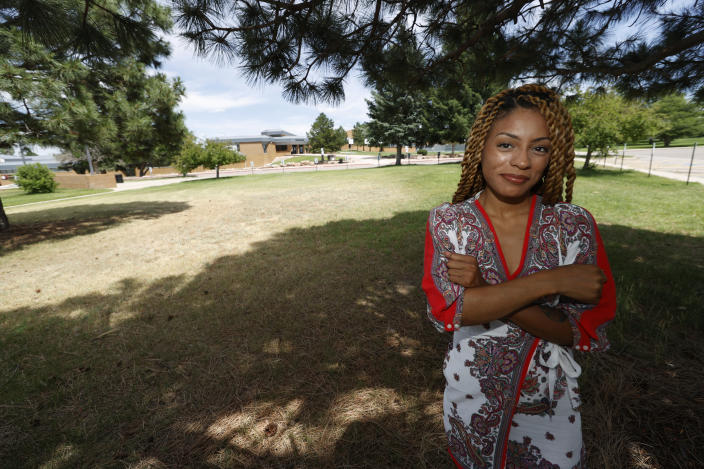 Tiera Brown stands outside Montbello High School in northeast Denver on June 22, 2020. Brown, 28, who supported Denver schools' decision to phase out officers, wonders if there would be more fellow Black students in her University of Denver law class if they had been treated with more understanding as young students. (AP Photo/David Zalubowski)