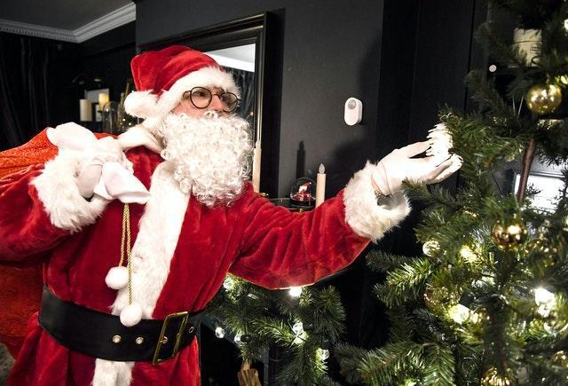 Children may question how Father Christmas can climb down a chimney when they do not have one (Doug Peters/PA).