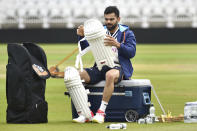 India captain Virat Kohli pads up during net practice prior to the first Test Match between England and India at Trent Bridge cricket ground in Nottingham, England, Monday, Aug. 2, 2021. (AP Photo/Rui Vieira)