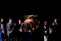 Relatives carry the coffin with the remains of Spanish dictator General Francisco Franco at the Valley of the Fallen mausoleum near El Escorial, outskirts of Madrid, Spain, Thursday, Oct. 24, 2019. Spain has exhumed the remains of Spanish dictator Gen. Francisco Franco from his grandiose mausoleum outside Madrid so he can be reburied in a small family crypt north of the capital. (AP Photo/J.J. Guillén, Pool)