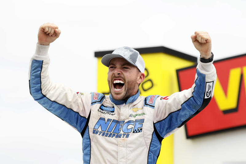 Ross Chastain celebrates in Victory Lane after winning a NASCAR Truck Series auto race, Sunday, June 16, 2019, at Iowa Speedway in Newton, Iowa. (AP Photo/Charlie Neibergall)