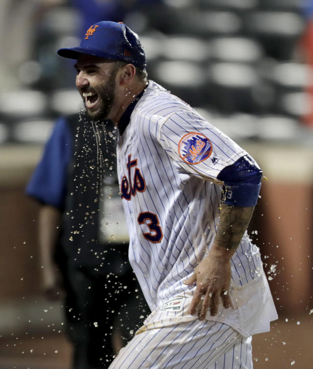 New York Mets' Tomas Nido reacts after teammates doused him with liquid after his walk-off solo home run off Detroit Tigers relief pitcher Buck Farmer during the 13th inning of a baseball game Saturday, May 25, 2019, in New York. The Mets won 5-4. (AP Photo/Julio Cortez)