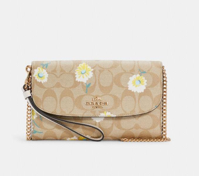 Gemma Clutch Crossbody In Signature Canvas With Daisy Print. Image via Coach Outlet.
