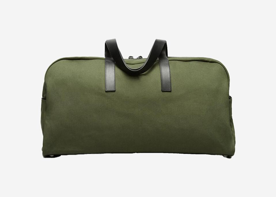 """<p>Crafted by the wildly popular direct-to-consumer line that turns out timeless wardrobe staples, this go-with-everything duffel is a minimalist's dream. It fits just as effortlessly in the overhead compartment as it does when you're playing luggage Tetris in the <a href=""""https://www.cntraveler.com/gallery/11-road-trip-essentials?mbid=synd_yahoo_rss"""" rel=""""nofollow noopener"""" target=""""_blank"""" data-ylk=""""slk:trunk of your car"""" class=""""link rapid-noclick-resp"""">trunk of your car</a>.</p> <p><strong>Buy now:</strong> <a href=""""https://fave.co/320zKdv"""" rel=""""nofollow noopener"""" target=""""_blank"""" data-ylk=""""slk:$98, everlane.com"""" class=""""link rapid-noclick-resp"""">$98, everlane.com</a></p>"""
