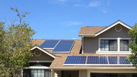 Solar panels installed by SolarCity on a residential rooftop in California.