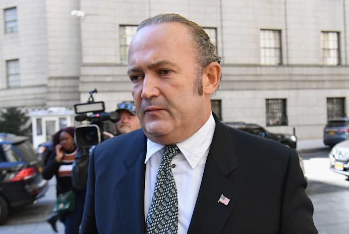 Photo shows Igor Fruman leaving Manhattan federal court in New York City after a criminal arraignment hearing on October 23, 2019. (Photo by Angela Weiss / AFP) (Photo by ANGELA WEISS/AFP via Getty Images) ORIG FILE ID: AFP_1LO3Z3