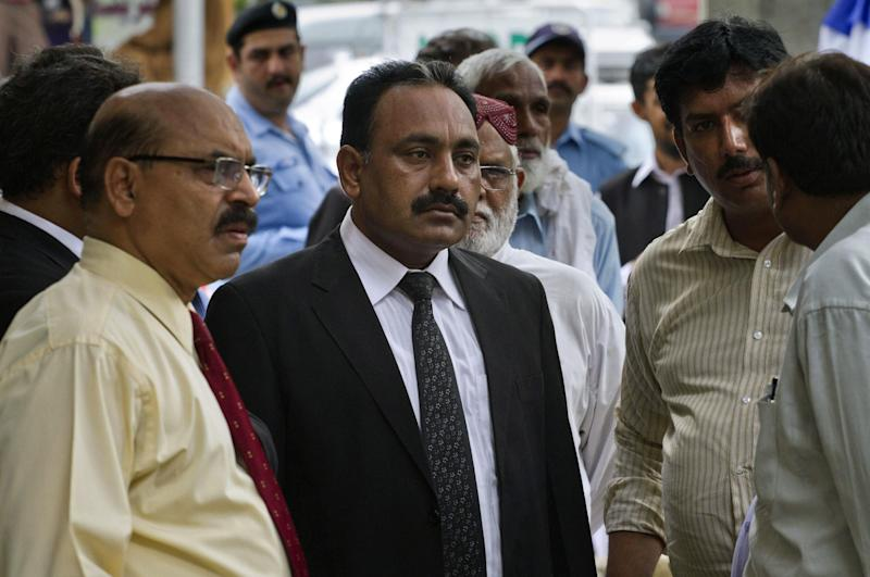 Tahir Naveed Chaudhry, center, a lawyer of a Christian girl accused of blasphemy, and other Christian community leaders wait for the start of a court proceeding in Islamabad, Pakistan on Tuesday, Aug. 28, 2012. Chaudhry said a report by a medical board investigating the age and mental state of the girl determined she was between 13 and 14. The girl was accused by a neighbor of burning pages from the Quran. (AP Photo/Anjum Naveed)