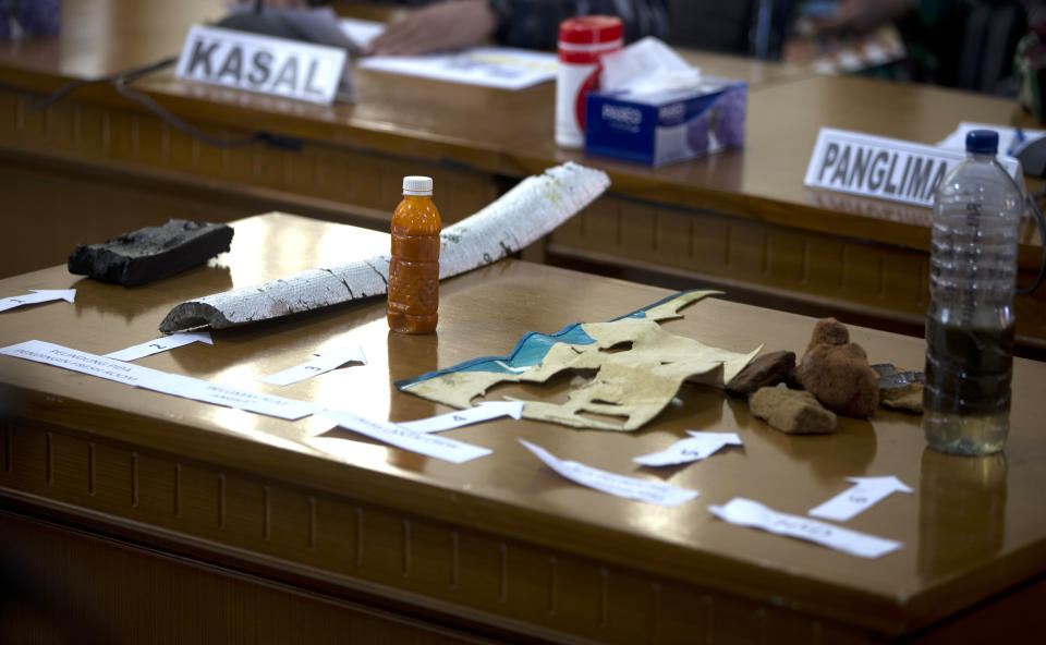Items found in the waters are seen on desk during a press conference for the missing Indonesian Navy submarine KRI Nanggala at Ngurah Rai Military Air Base in Bali, Indonesia on Saturday, April 24, 2021. Indonesian submarine The KRI Nanggala 402 went missing after its last reported dive Wednesday off the resort island, and concern is mounting it may have sunk too deep to reach or recover in time.(AP Photo/Firdia Lisnawati)